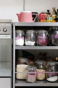 Anne Mette Skodbor, Copenhagen home, pink painted labeled glass jars in kitchen | Remodelista