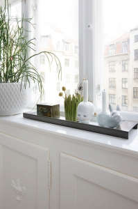 Anne Mette Skodbor, Copenhagen home, plants on window ledge in white bedroom | Remodelista