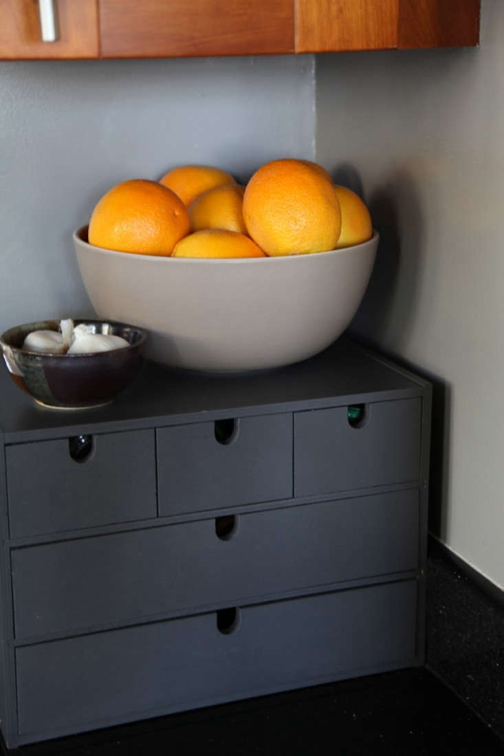 Apartment Rental Kitchen with Ikea Drawers Set Painted Dark Gray and Heath Bowl with Oranges