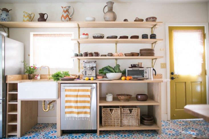 An ad-hoc modular workspace with custom-built ash shelving that takes advantage of every inch of storage space in this Kitchen of the Week: An Echo Park Kitchen Revived, Budget Edition. Photograph by Nancy Neil.