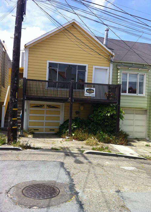 The original house (shown left, in yellow) had a garage on the ground floor and one-bedroom living quarters upstairs.