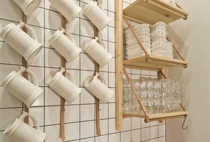 Bestie-Currywurst-Scott-and-Scott-Architects-hanging-steins-Remodelista