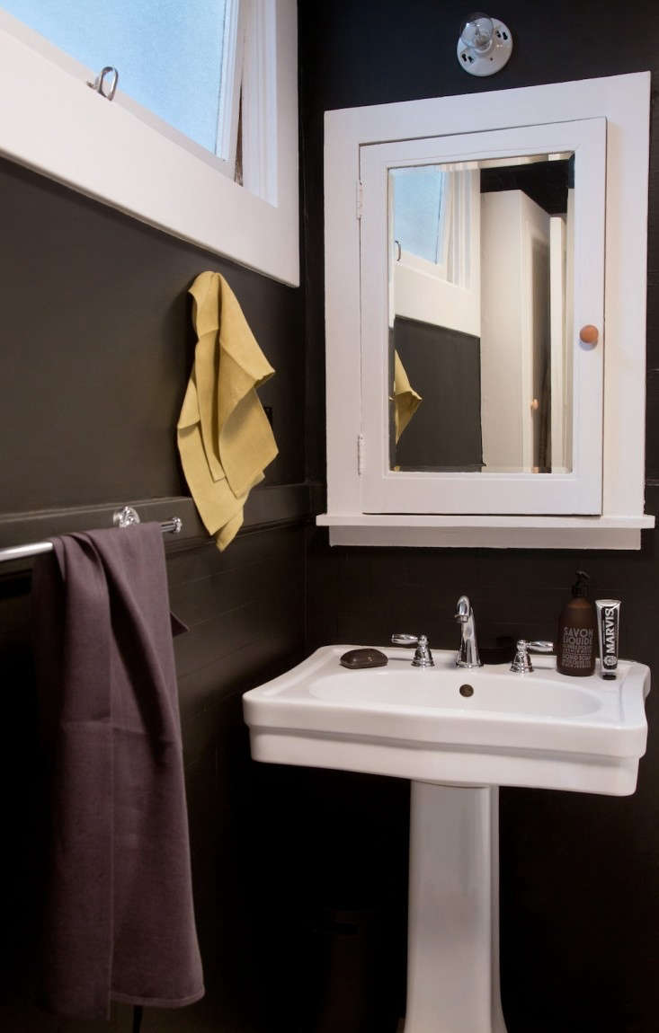 Black Bathroom with Green Linen Hand Towel and White Pedestal Sink, Remodelista