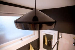 Black Industrial Pendant Light in Black Bathroom, Remodelista