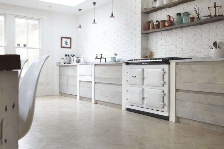 the designer is in a scandi kitchen in a london victorian
