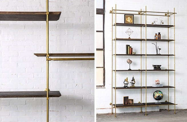 Brass-and-oak-shelving-system-from-amuneal-against-white-brick-Remodelista