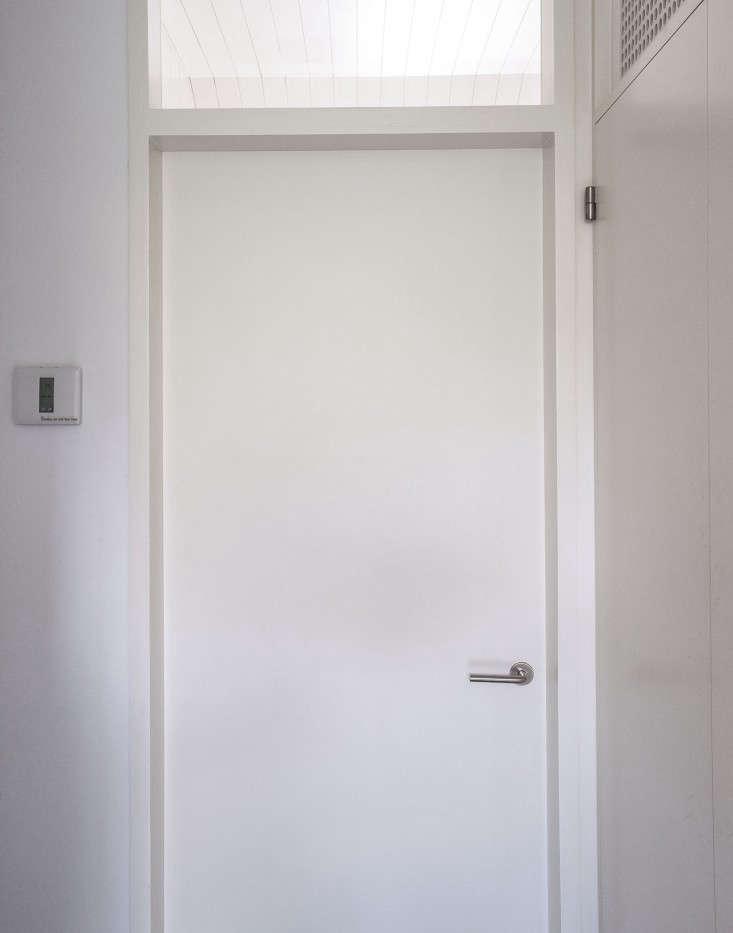 Brooklyn-bathroom-remodel-Fernlund-and-Logan-door-with-D-Line-handle-Remodelista