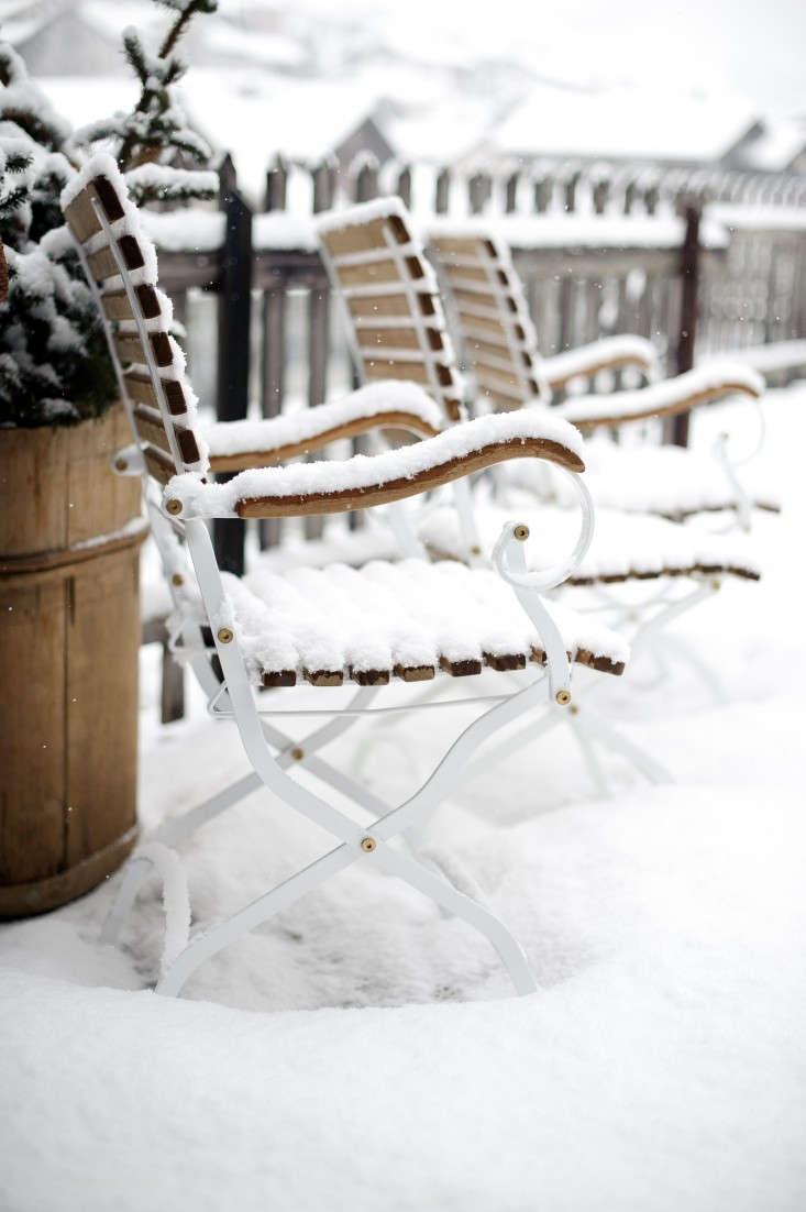 Brucke49-mountain-B&B-Vals-Switzerland-chairs-in-snow-Remodelista