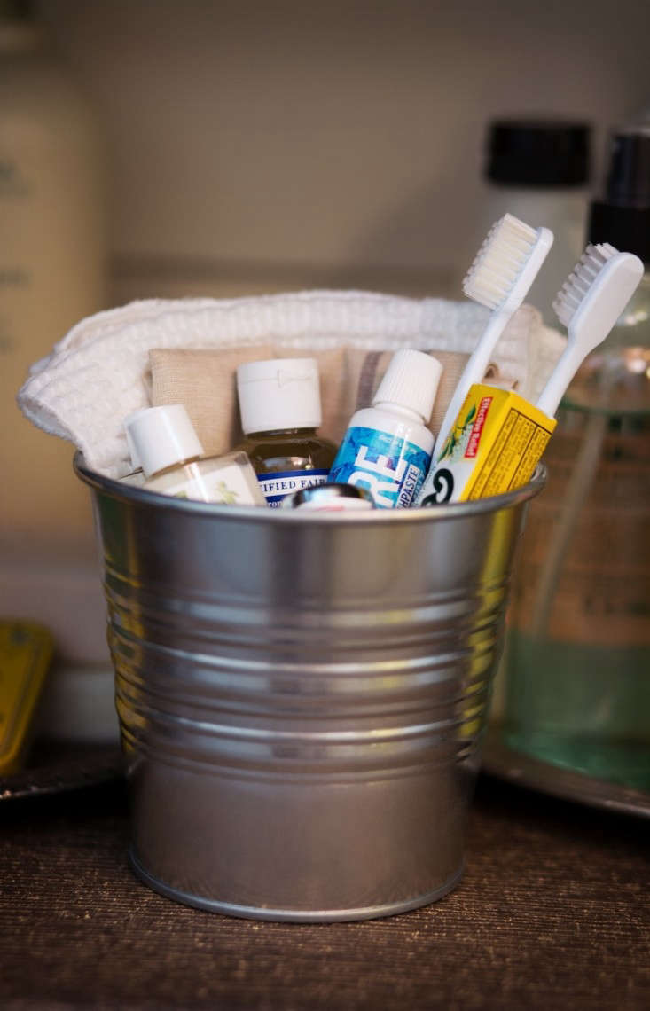 Bucket for Guests with Toothbrushes, Soaps, Remodelista