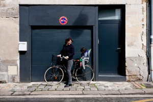 Caroline Gomez on bicycle outside of her Bordeaux House | Remodelista