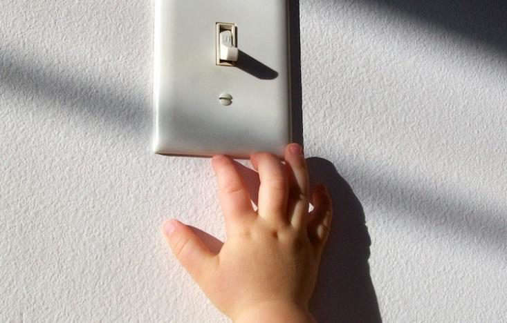 Child-reaching-for-light-switch