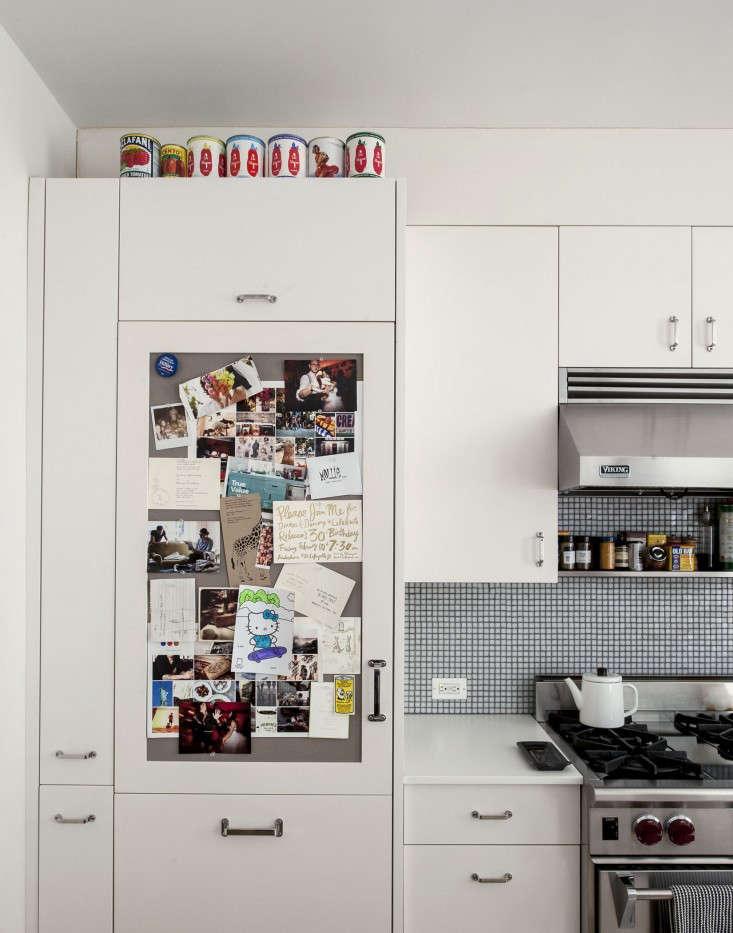 cobble hill duplex by oliver freundlich sub zero with pinboard door remodelista corian countertops
