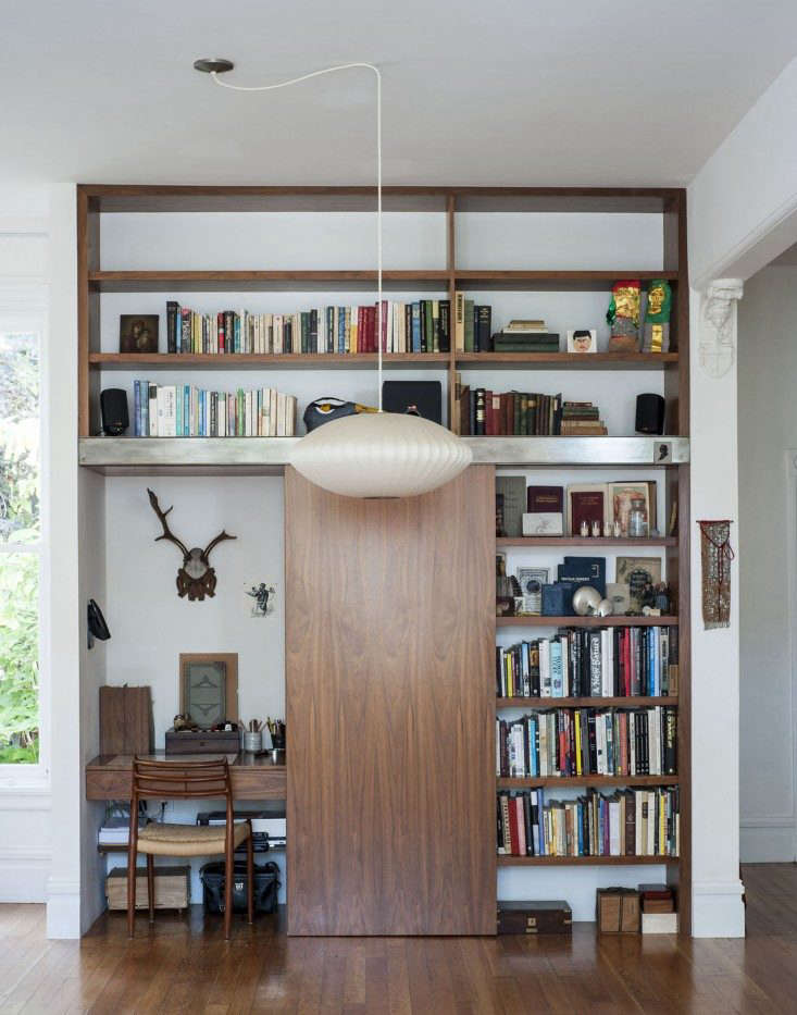 Dagmar-Daley-sliding-bookshelf-home-office-2-Remodelista