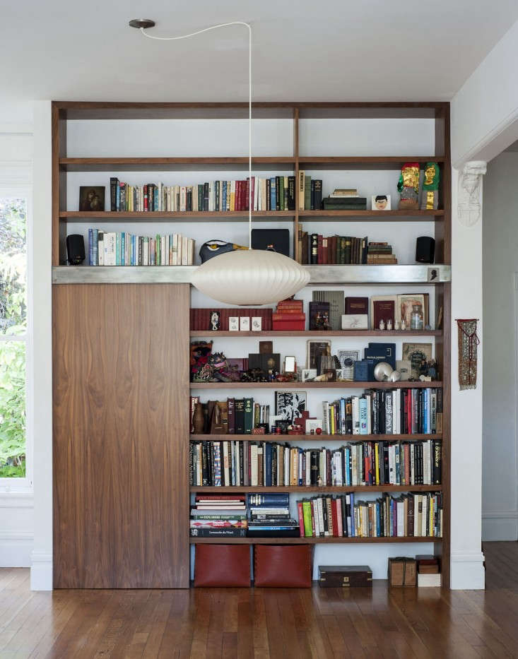 Dagmar-Daley-sliding-bookshelf-home-office-Remodelista
