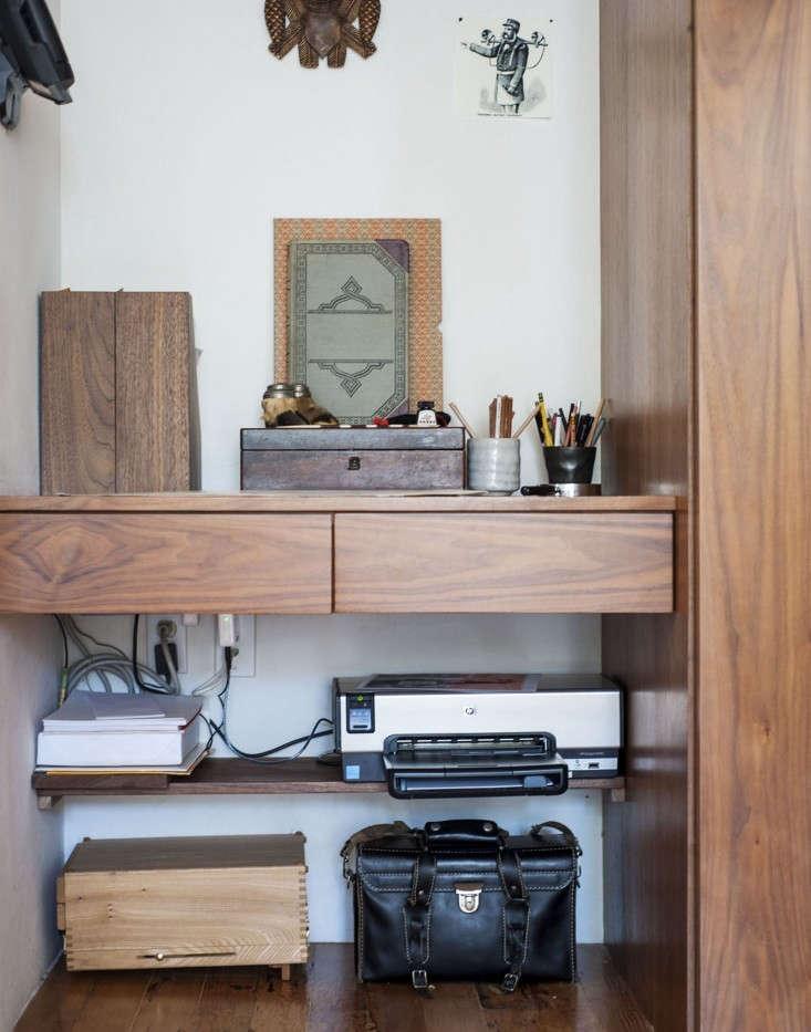 Dagmar-Daley-sliding-bookshelf-home-office-desk-2-Remodelista