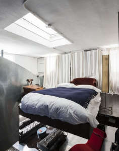 David Ling Architect, Live/Work sudio in New York, bed in loft space | Remodelista