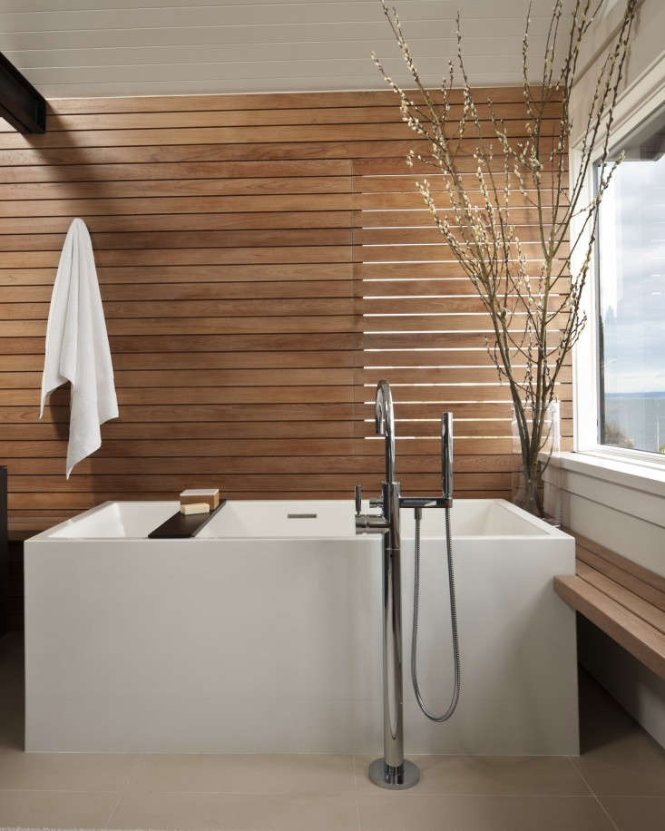 DeForest Architects Bath with Wood Wall Paneling and Wood Bench and Soaking Tub, Remodelista