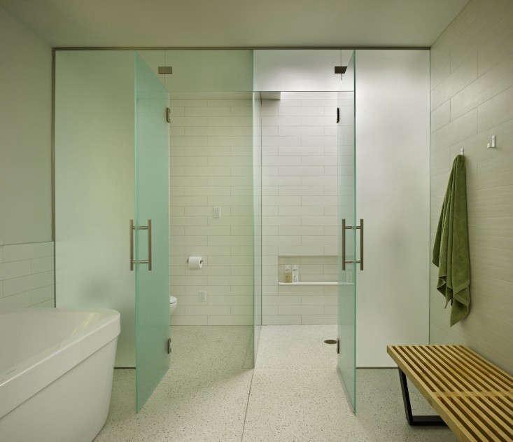 Deforest Architects Bath with Green Spa Glass Doors and Noguchi Bench, Remodelista