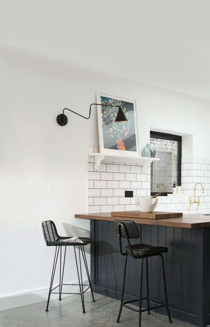 In a London kitchen by deVol, the designers paired iroko wood with marble countertops.