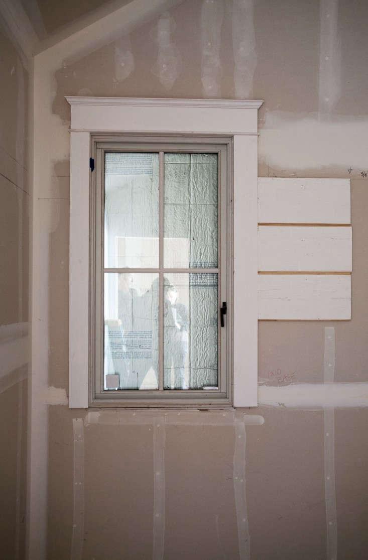 Erio-Brown-Construction-window-trim-Remodelista