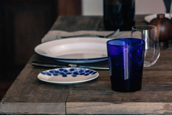 Greek-inspired-table-setting-enamel-plate-and-blue-glass-cup-Remodelista