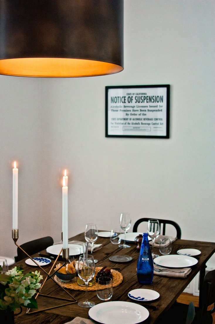 Greek-inspired-table-setting-in-San-Francisco-notice-of-suspension-sign-Remodelista