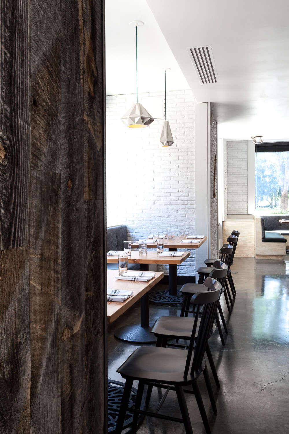 Hock Farm Restaurant with Black Windsor Chairs and Concrete Floor