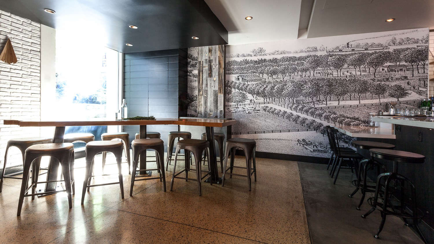 Hock Farm Restaurant with Metal Stools and Black and White Wallpaper