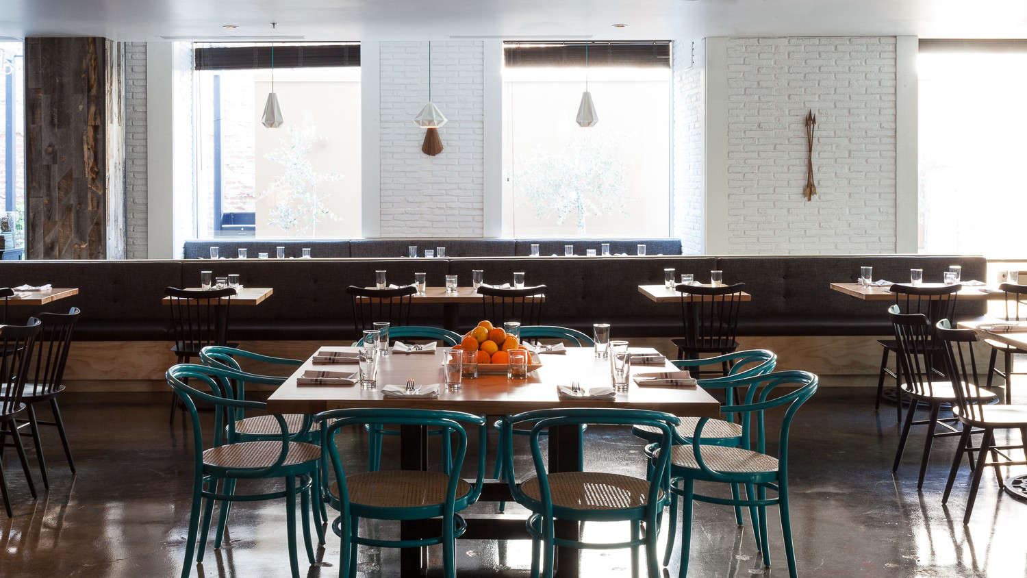 Hock Farm Restaurant with Turquoise Bentwood Chairs and White Painted Brick Walls