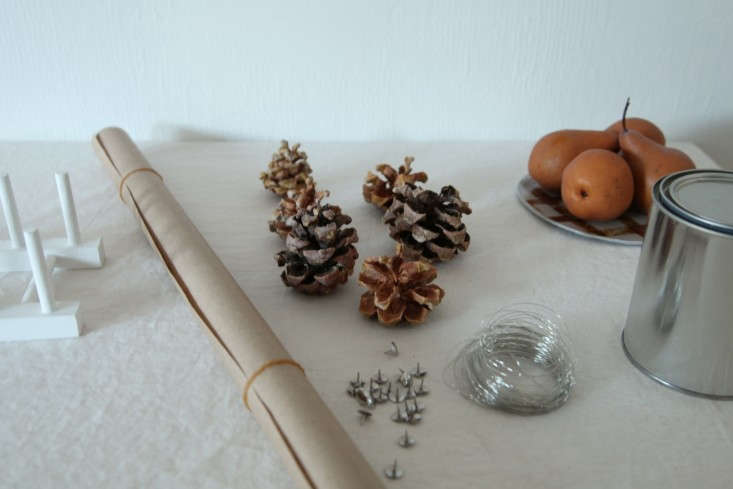 Holiday-Decor-for-Kids-DIY-White-Painted-Pine-Cones-Remodelista-01