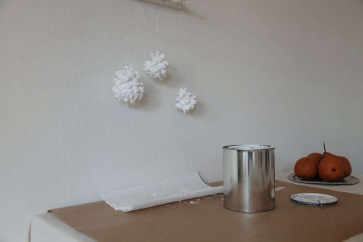 Holiday-Decor-for-Kids-DIY-White-Painted-Pine-Cones-Remodelista-08