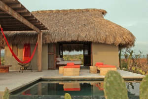 Palapa Thatched Palm Roof at Hotel Escondido in Mexico with Plunge Pool and Orange Outdoor Furniture, Remodelista