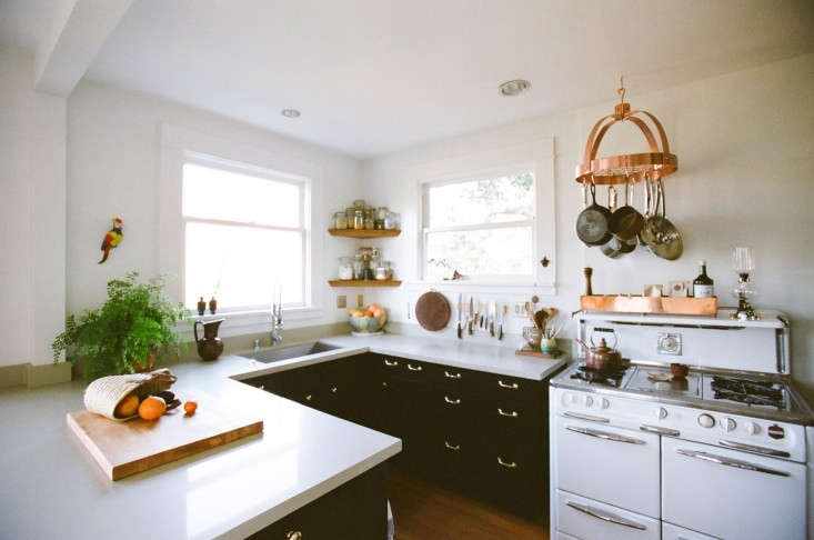 When jewelry designer Kathleen Whitaker remodeled her turn-of-the-century home in Echo Park, Los Angeles, she found she liked the way the existing U-shaped kitchen formed a separate cooking area from the dining area. Whitaker's only update was to repaint the cabinets in Avocado Peel from Martha Stewart Living. (Take a stroll through Whitaker's equally inviting garden in Tropical Paradise in LA's Echo Park.) Photograph byNancy Neil.