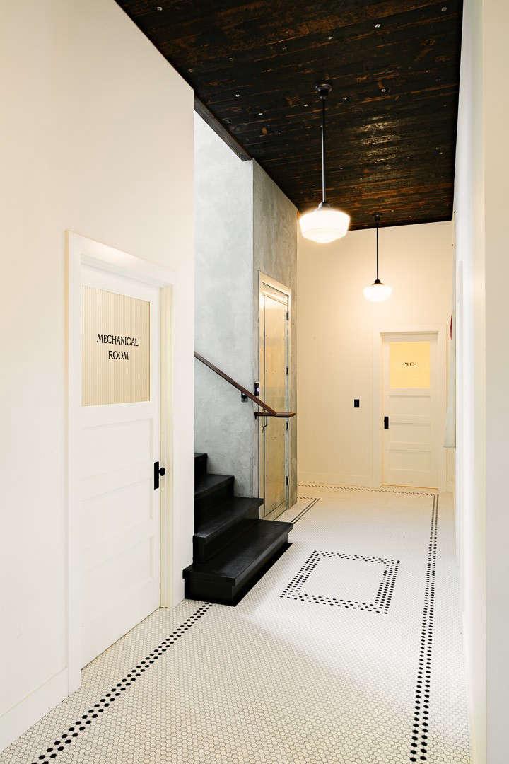 Industrial-Portland-loft-tiled-hall-Remodelista