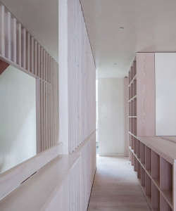 Jonathan Tuckey, Submariner's House, White stair rails, built in bookshelves in hall, London | Remodelista