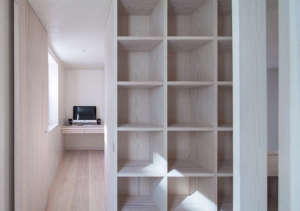Jonathan Tuckey, Submariner's House, Built in shelves as room divider, London | Remodelista