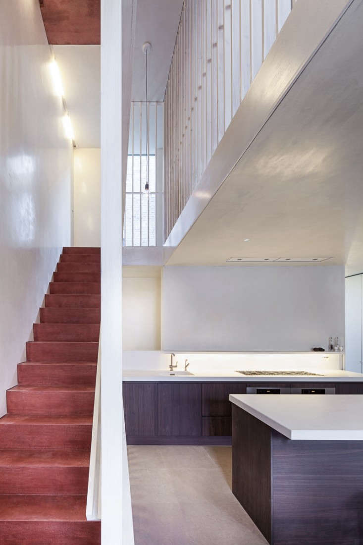 Jonathan-Tuckey-Ex-Submariner's-House-Red-pigment-concrete-stairs-London-Remodelista