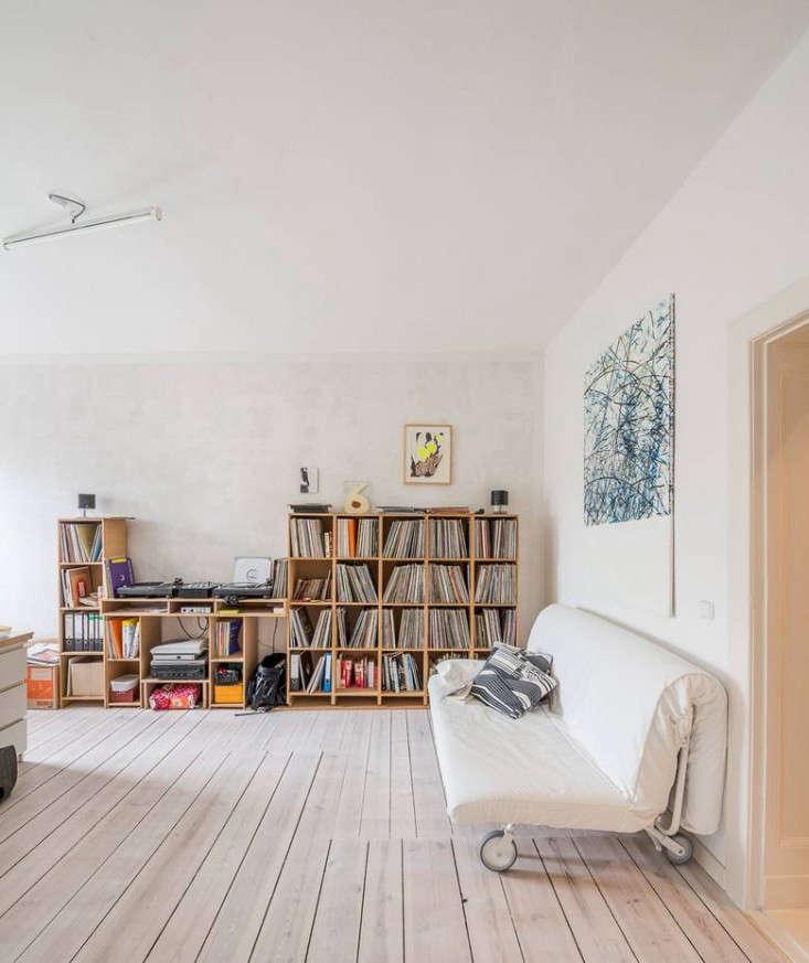 Karhard-Berlin-Flat-Bookshelves-White-Floors-Remodelista-01