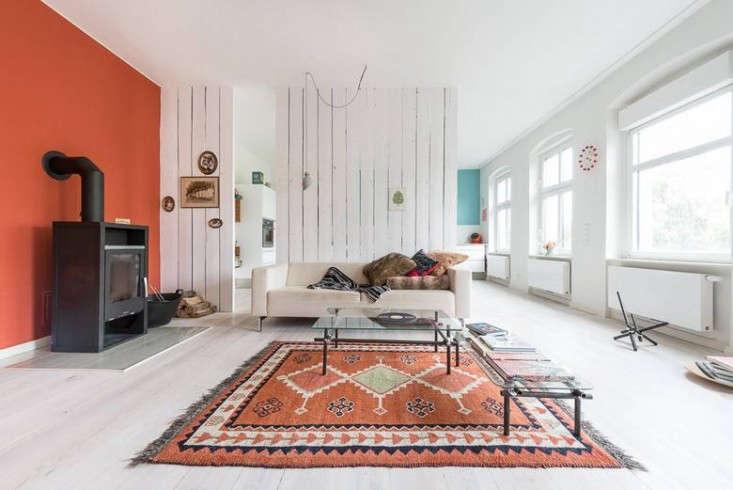 Karhard-Berlin-Flat-Red-Living-Room-Wall-Remodelista-01