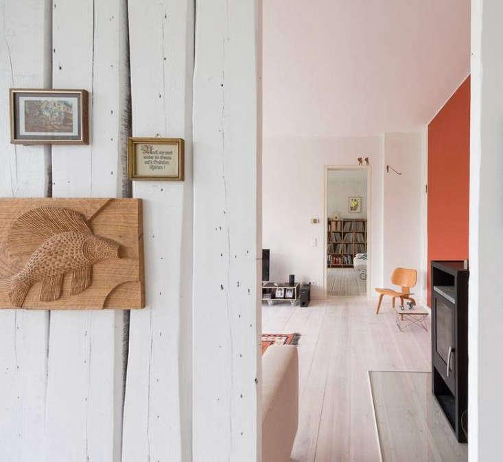 Karhard-Berlin-Flat-Red-Living-Room-Wall-Remodelista-02