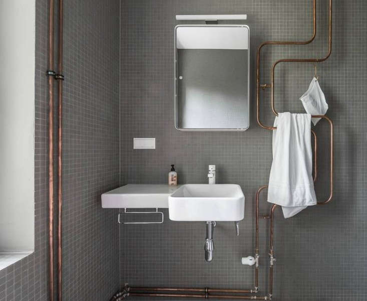 Karhard-Berlin-House-Remodel-gray-tiled-bathroom-exposed-copper-pipes ...