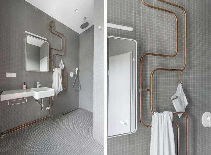 Karhard-Berlin-House-Remodel-gray-tiled-bathroom-exposed-copper-pipes-Remodelista-02