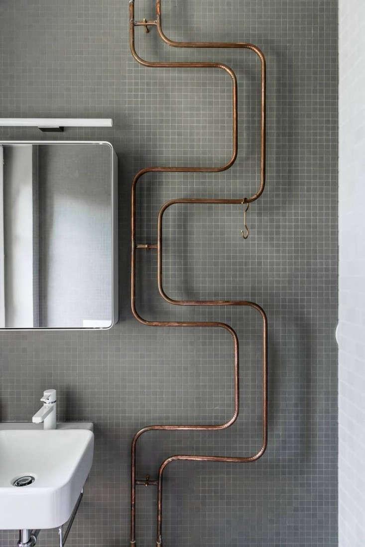 Karhard-Berlin-House-Remodel-gray-tiled-bathroom-exposed-copper-pipes-Remodelista-03