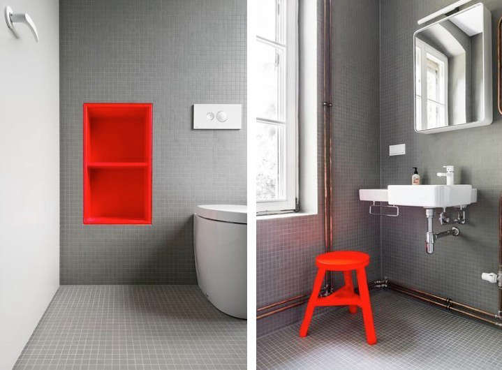 Karhard berlin house remodel gray tiled bathroom red shelves and stool