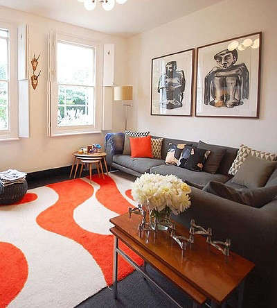 Kate Monckton Kew House Living Room with Mod Orange Rug and Gray Couch, Remodelista