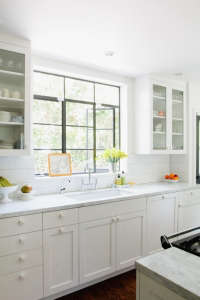 Barbara Bestor-designed white kitchen cabinets, Remodelista