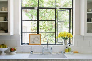 Bridge faucet and Carrara marble counter in Barbara Bestor kitchen, Remodelista