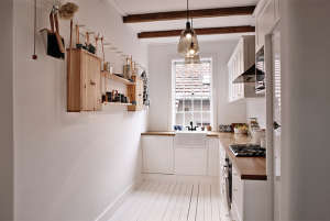 Kitchen Shelves Hanging from Rope in a Swedish Cottage I Remodelista
