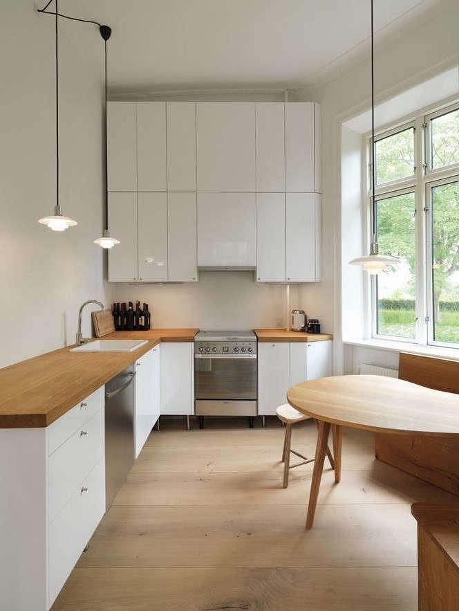 white l shaped kitchen in copenhagen image via archilovers