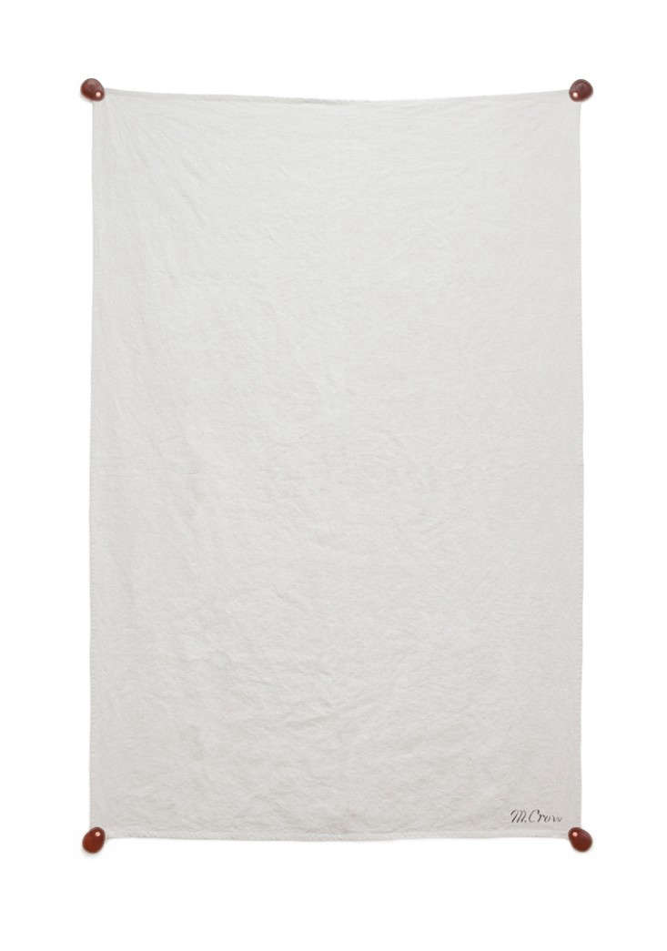 MCrow-linen-beach-blanket-with-leather-weights-Remodelista